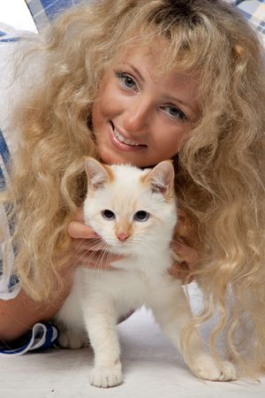 Portrait of the beautiful girl with a kitten on a white background. photo