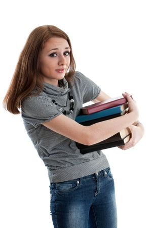 The attractive student stands with books on a white background. The student. Stock Photo - 6427792