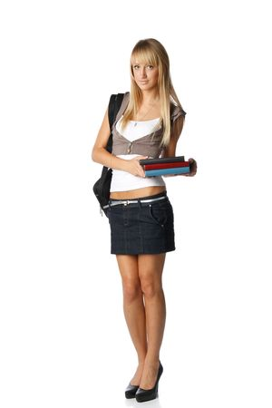 The attractive student stands with books and a bag on a white background. The student. Stock Photo - 6427893