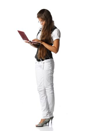 The attractive young woman stands with the laptop on a white background. Stock Photo - 6427796