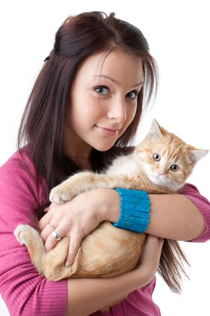 The happy young woman with a small amusing kitten on a white background. Stock Photo - 6465066