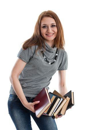 The attractive student stands with books on a white background. The student. Stock Photo - 6465082