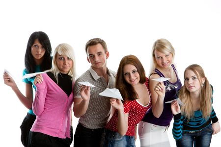 student travel: Group of young happy people with paper planes on a white background.