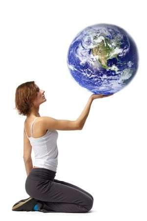 Young  beautiful woman with globe on a white background. photo