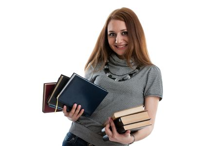 The attractive student stands with books on a white background. The student. Stock Photo - 6506530