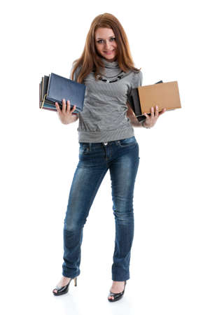 The attractive student stands with books on a white background. The student. Stock Photo - 6506545
