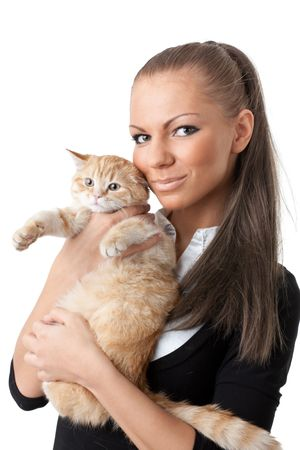 The happy young woman with a small amusing kitten on a white background. photo