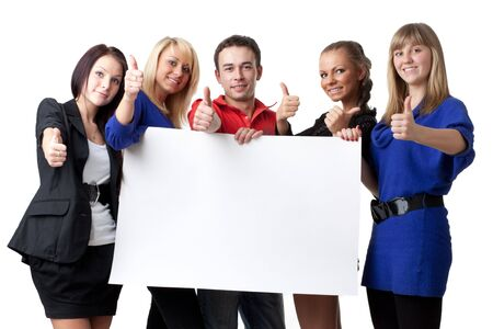 The group of young people holds the empty board for the text on a white background. photo