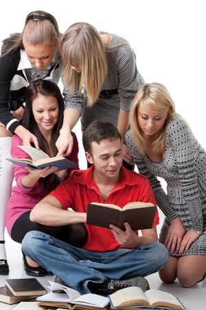 The clever young people  sitting with books on a white background. photo