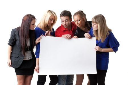 advertising board: The group of young people holds the empty board for the text on a white background. Stock Photo