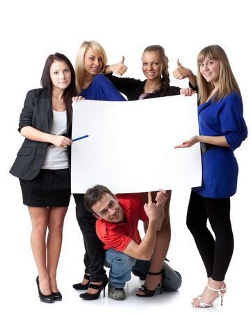 The group of young people holds the empty board for the text on a white background. Stock Photo - 6594412