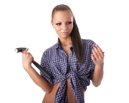 Young woman with hammer and nail on a white background. photo