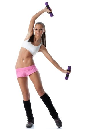 The beautiful sports girl with dumbbells on a white background. Training. Stock Photo - 6618618