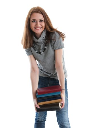 The attractive student stands with books on a white background. The student. Stock Photo - 6618621