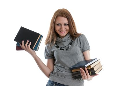 The attractive student stands with books on a white background. The student. Stock Photo - 6618667