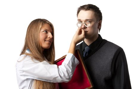 The beautiful  female oculist  checks sight at the patient on a white background. Stock Photo - 6661914