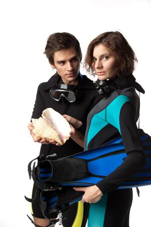 wetsuit: Young happy people with diving suits with a seashell on a white background.