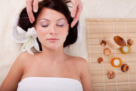 Young beautiful woman getting spa treatment  on a  white background Stock Photo - 6661951
