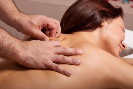 Young beautiful woman on massage procedure in salon Stock Photo - 6661942