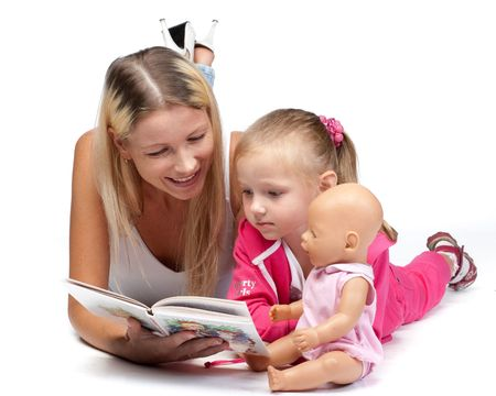 Young mum reads the interesting book to the daughter on a white background. Stock Photo - 6661940
