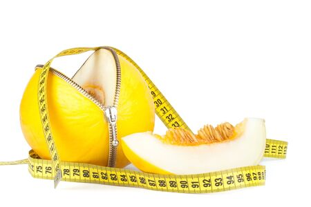Unzipped melon and measuring tape. Healthy eating concept. Close up. Stock Photo - 6695652