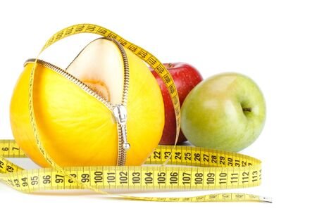 Unzipped melon, apples and measuring tape. Healthy eating concept. Close up. photo