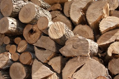 Abstract background from the firewood stacked on outdoors. photo