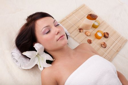 Young beautiful woman getting spa treatment  on a  white background Stock Photo