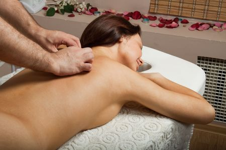 Young beautiful woman on massage procedure in salon Stock Photo - 6715904