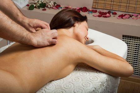 Young beautiful woman on massage procedure in salon Stock Photo - 6715904