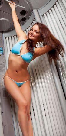 tan woman: Young beautiful woman in bikini  in a solarium