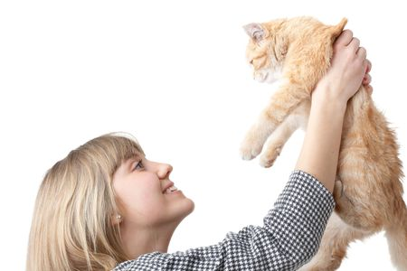 amusing: The happy young woman with a small amusing kitten on a white background.