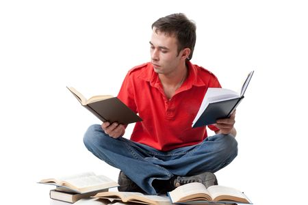 The clever young man  sitting with books on a white background. Stock Photo - 6752530