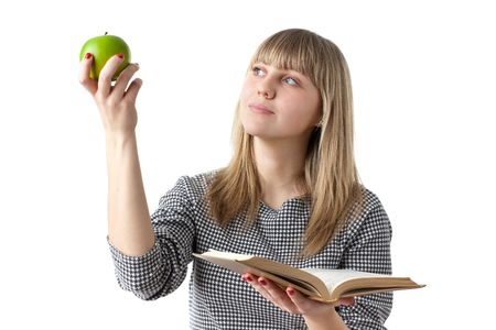 Young beautiful woman with book and apple on a white background. Student. photo
