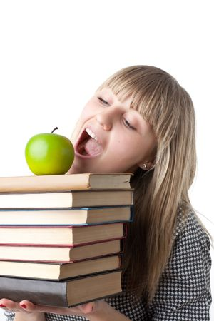 Young beautiful woman with books and apple on a white background. Student. Stock Photo - 6752529