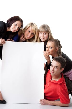 The group of young people holds the empty board for the text on a white background. Stock Photo - 6752531