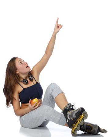 inline skates: The beautiful girl  in rollerskates with an apple on a white background.