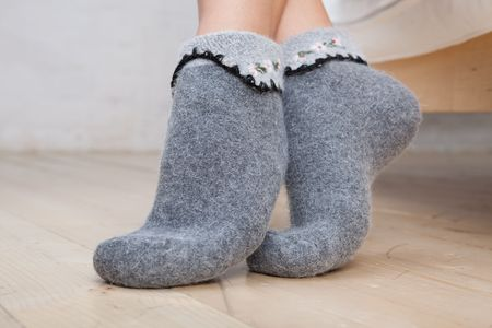 Legs of young woman wearing socks. Close up. photo