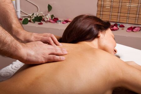 Young beautiful woman on massage procedure in salon Stock Photo - 6814235