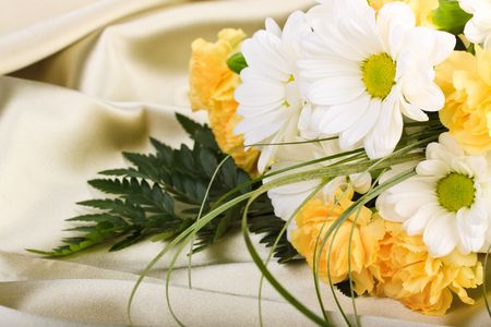 sateen: Beautiful bouquet of flowers on background of beige sateen