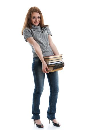 The attractive student stands with books on a white background. The student. Stock Photo - 6878062