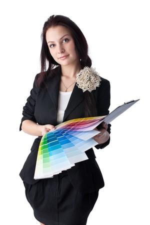 designers interior: La bella ragazza con una guida di colore su uno sfondo bianco.
