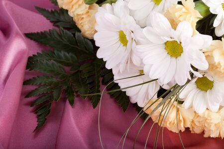 sateen: Beautiful bouquet of flowers on background of pink sateen