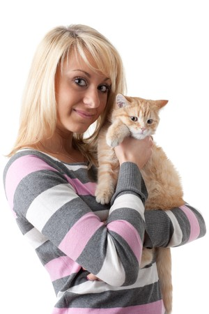 endearing: The happy young woman with a small amusing kitten on a white background.