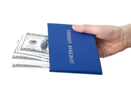 Hand with the record book and money on a white background.  Bribe. photo