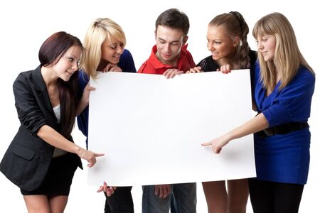 The group of young people holds the empty board for the text on a white background. Stock Photo