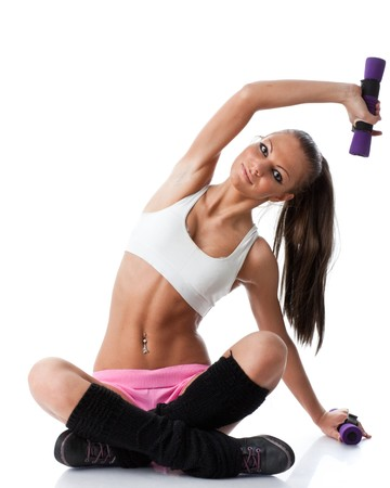 The beautiful sports girl with dumbbells on a white background. Training. photo