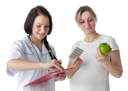 Pregnant woman and doctor on a white background. Concept of healthy food. photo