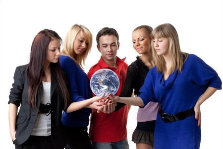 The group of young people holding the globe in hands on a white background.  Concept for environment conservation. photo