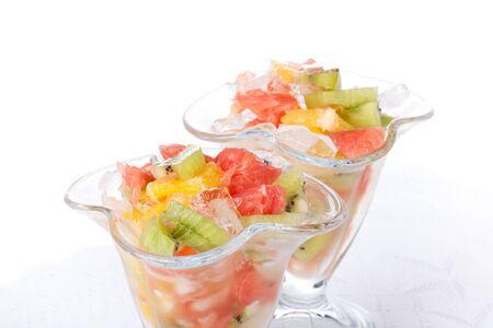 Fresh fruit salad on a white background. Dessert. photo